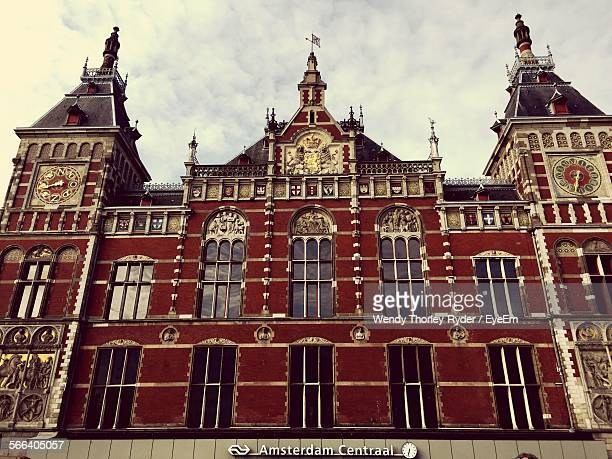 Low Angle View Of Amsterdam Centraal Railway Station Against Cloudy Sky