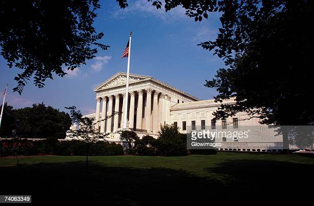Low angle view of an American flag in front of a government building, US Supreme Court, Washington DC, USA