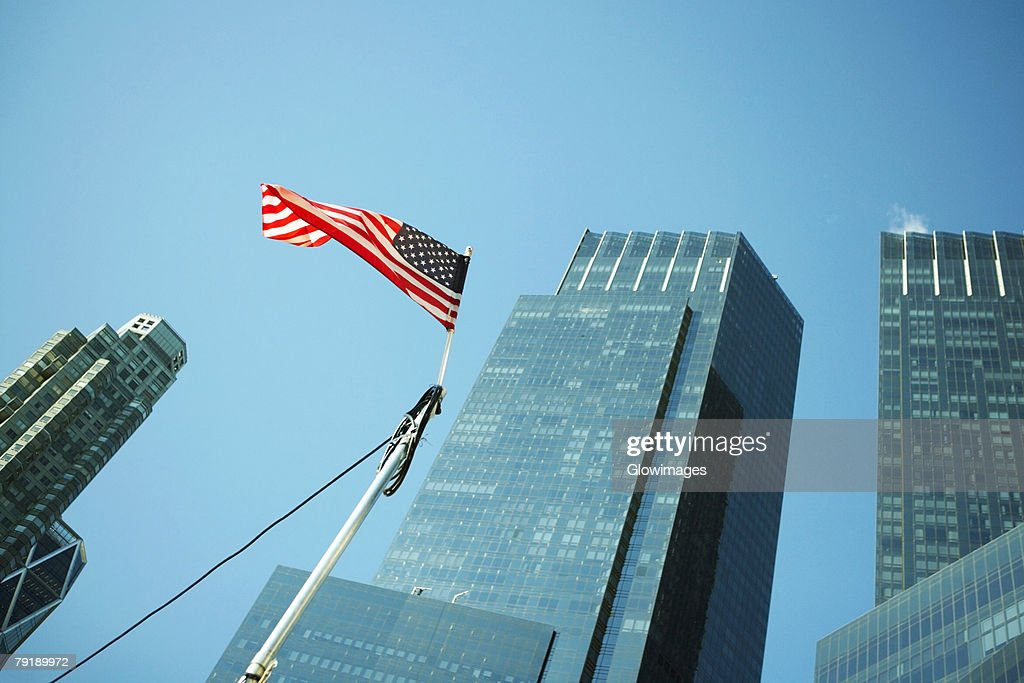 Low angle view of an American flag in front of buildings, World Trade Center, Manhattan, New York City, New York State, USA : Stock Photo