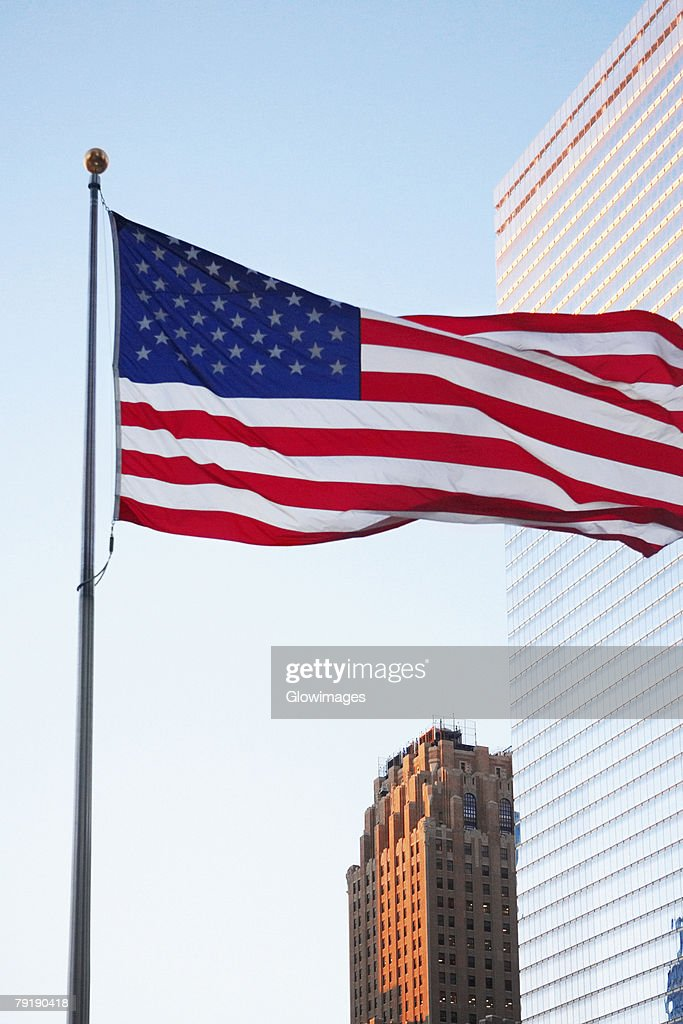 Low angle view of an American flag, World Trade Center, Manhattan, New York City, New York State, USA : Stock Photo