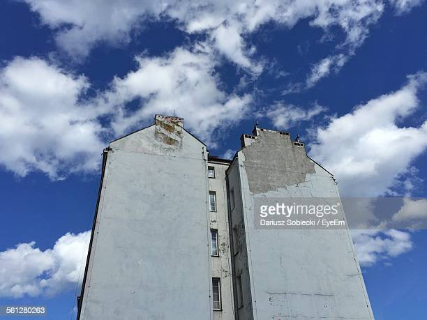 Low Angle View Of Apartment Building Against Cloudy Sky