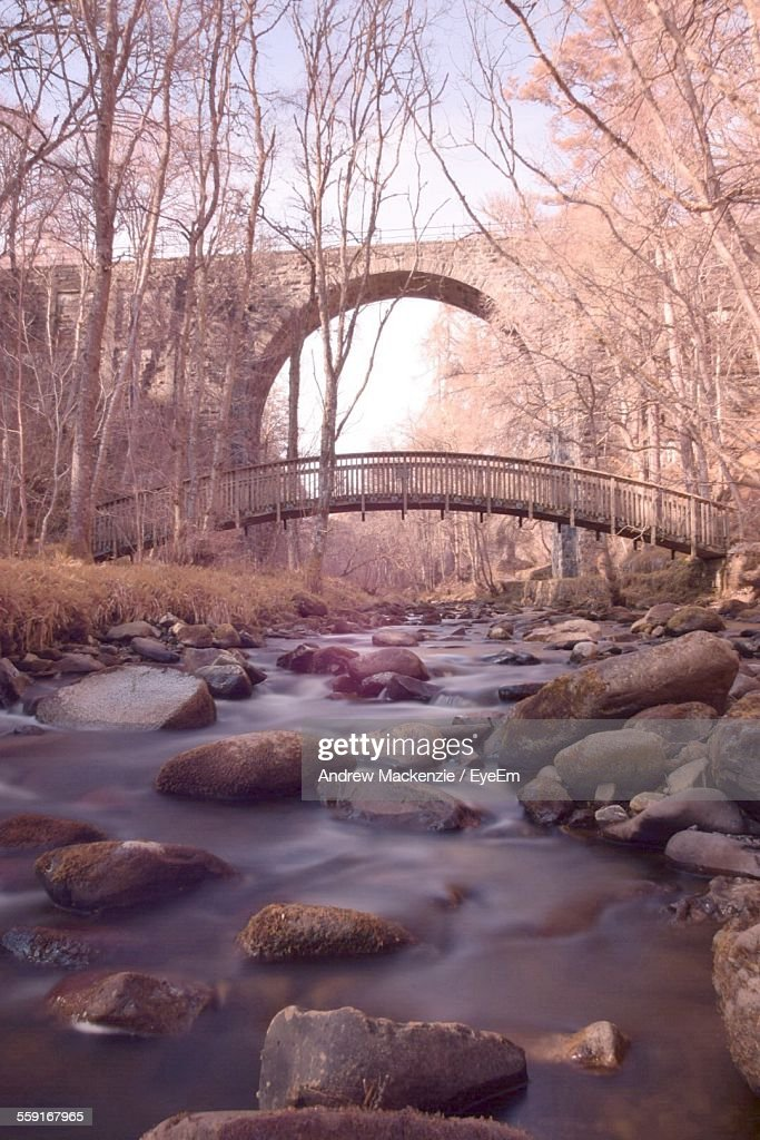 Low Angle View Of Arch Bridge Over River