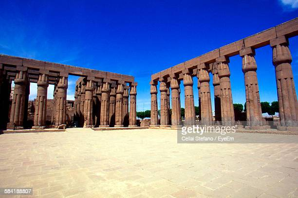 Low Angle View Of Architectural Columns Against Blue Sky At Karnak Temple