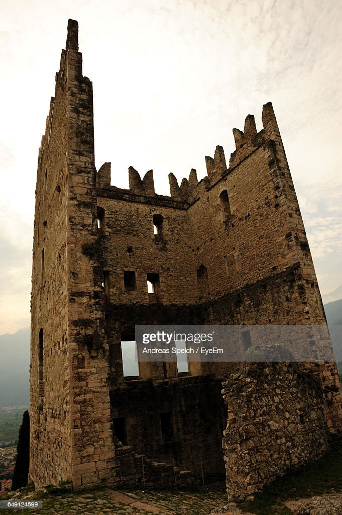 Low Angle View Of Arco Castle Against Sky