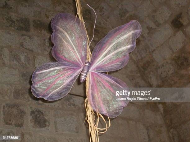 Low Angle View Of Artificial Butterfly Against Wall