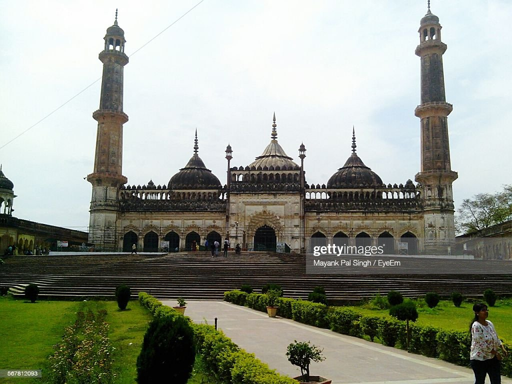 Low Angle View Of Bara Imambara Against Cloudy Sky