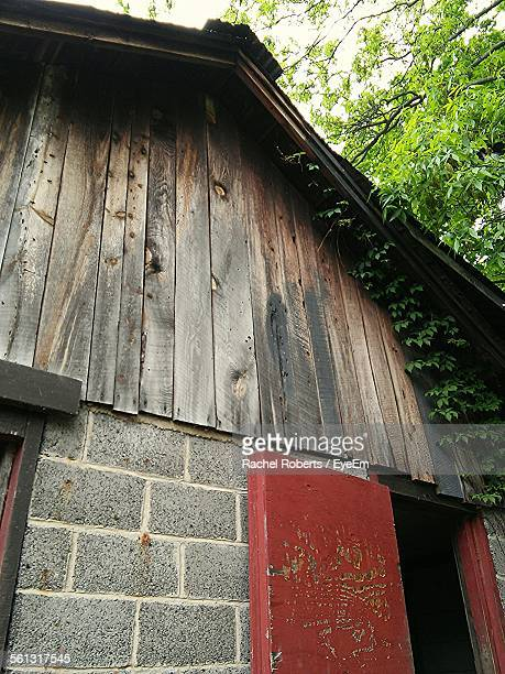 Low Angle View Of Barn With Stone And Wooden Wall