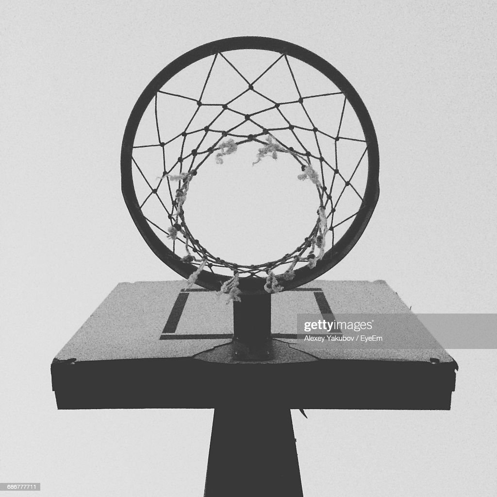 low angle view of basketball hoop against clear sky stock photo