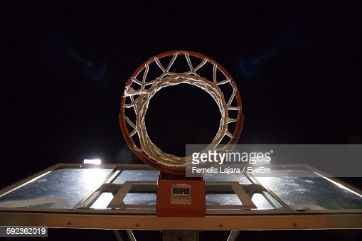 Low Angle View Of Basketball Hoop Against Sky At Night