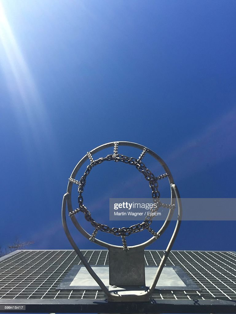 low angle view of basketball hoop against sky stock photo getty