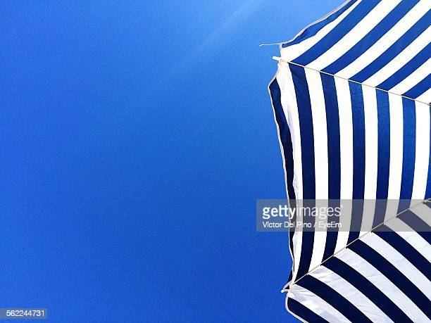 Low Angle View Of Beach Umbrella Against Clear Blue Sky
