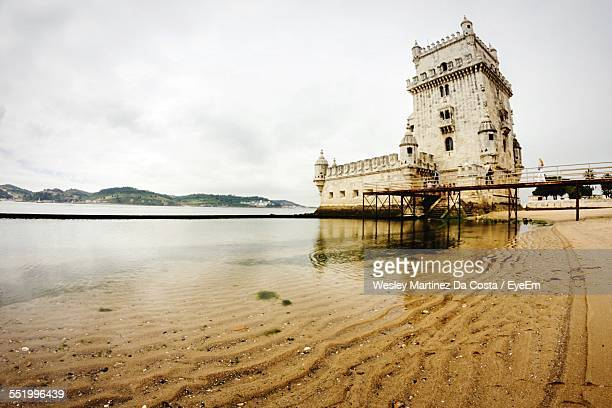 Low Angle View Of Belem Tower At Riverbank