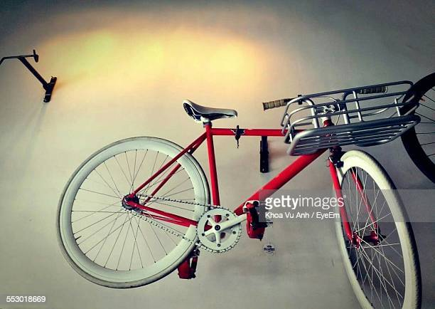 Low Angle View Of Bicycle Hanging On Wall