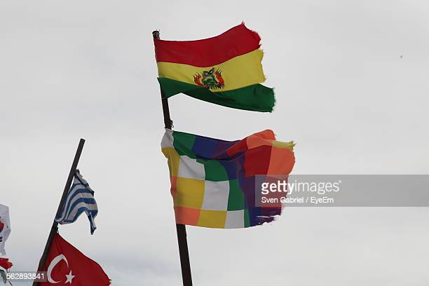 Low Angle View Of Bolivian Flags Against Clear Sky
