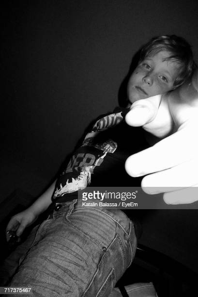 Low Angle View Of Boy Gesturing Against Wall