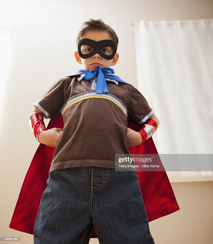 Low angle view of boy (6-7) in fancy dress costume