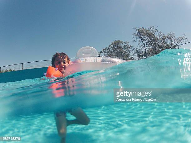 Low Angle View Of Boy Swimming In Pool