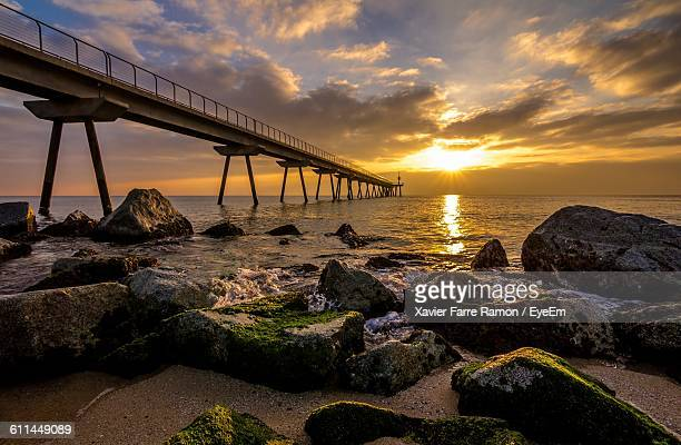 Low Angle View Of Bridge On Calm Sea