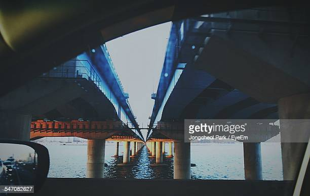 Low Angle View Of Bridge Over Han River Seen Through Car