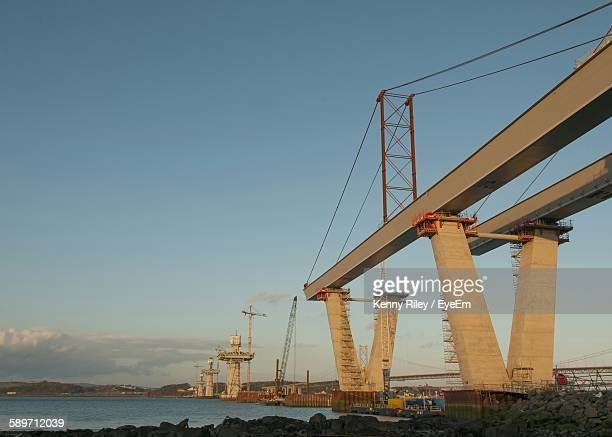 Low Angle View Of Bridge Under Construction Against Sky
