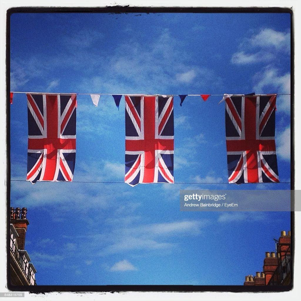 low angle view of british flags against the sky stock photo