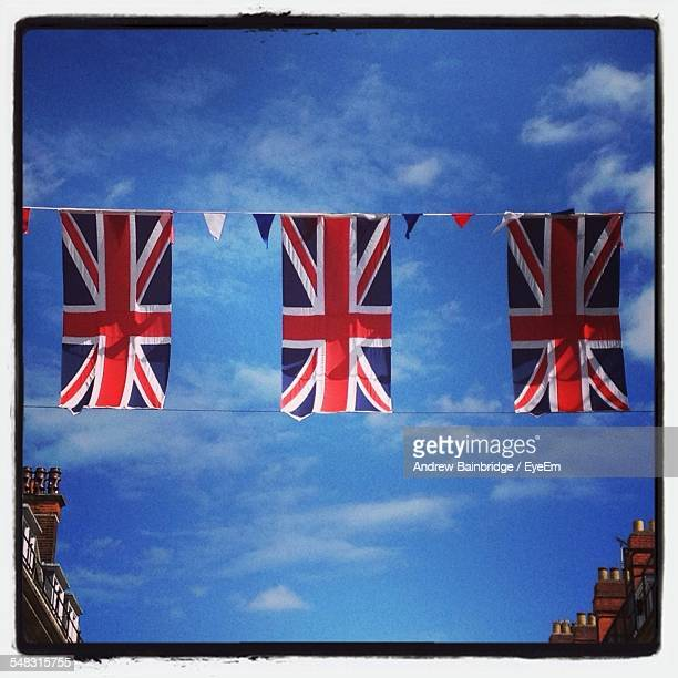 Low Angle View Of British Flags Against The Sky