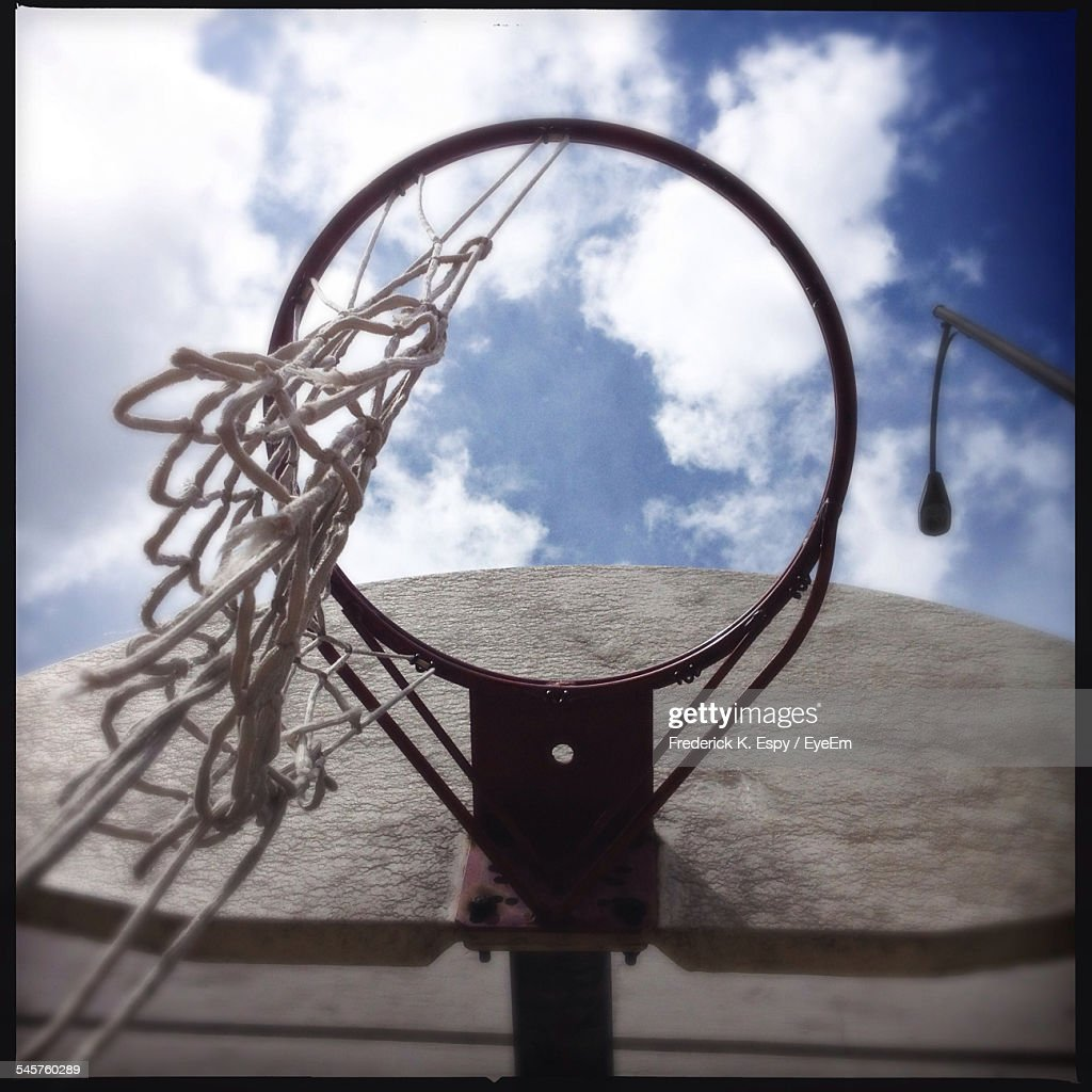 low angle view of broken basketball hoop against the sky stock
