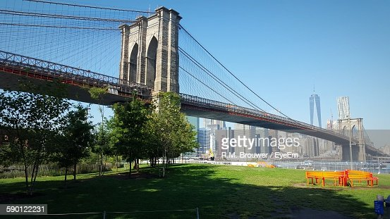Low Angle View Of Brooklyn Bridge Over East River Against Clear Sky