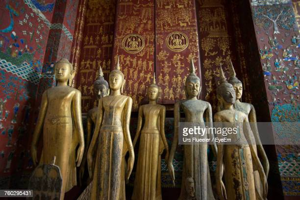 Low Angle View Of Buddha Statues At Wat Xieng Thong