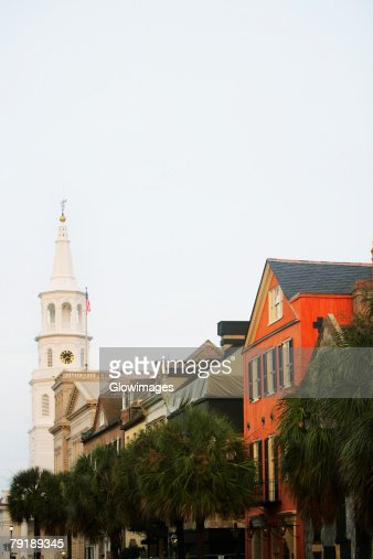 Low angle view of buildings and a church, St. John's Lutheran Church, Charleston, South Carolina, USA : Foto de stock