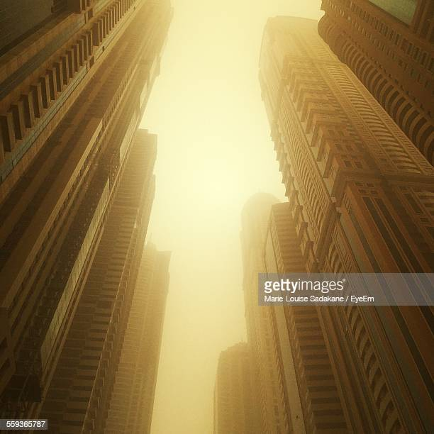Low Angle View Of Buildings In Sandstorm