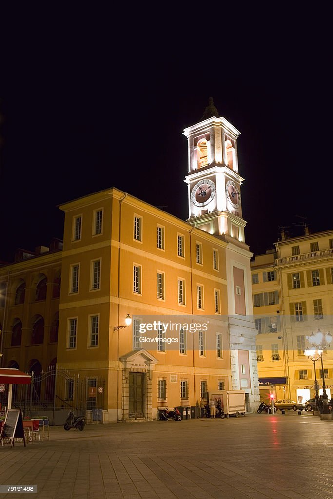 Low angle view of buildings lit up at night, Nice, France : Foto de stock