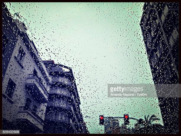 Low Angle View Of Buildings Seen Through Wet Glass During Rains