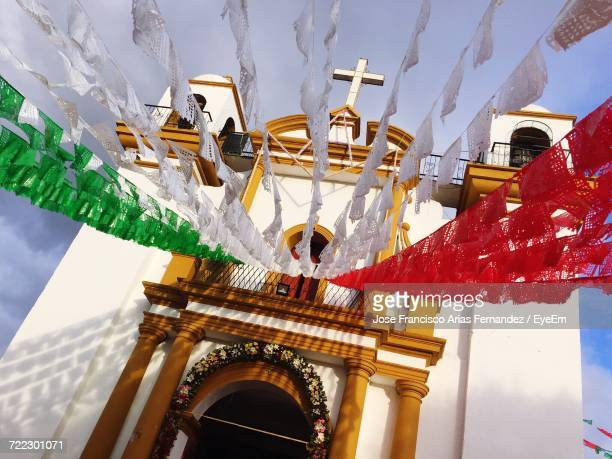 Low Angle View Of Buntings Hanging Against Church