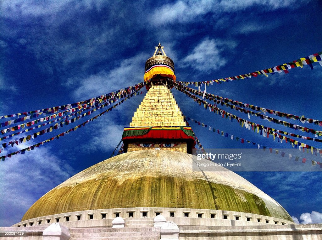 Low Angle View Of Buntings On Boudhanath Stupa Against Sky
