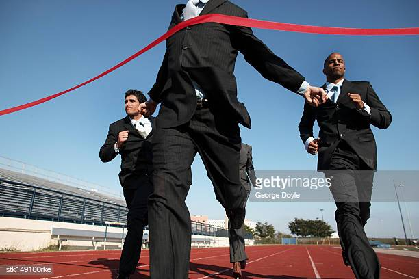 low angle view of business executives crossing the finish line