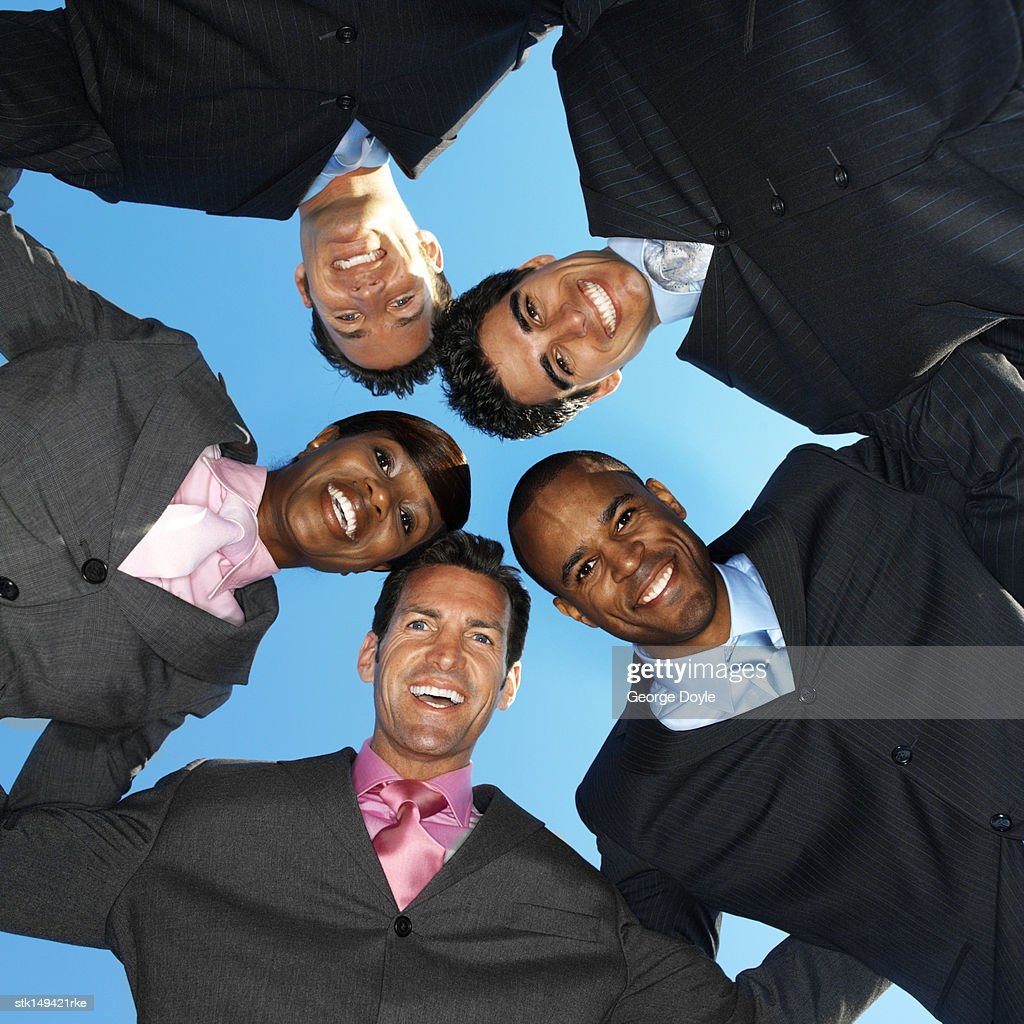 low angle view of business executives in a huddle : Stock Photo