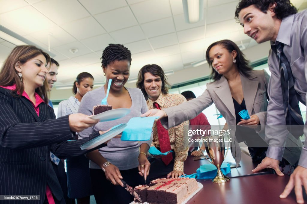Low angle view of business executives in an office party : Stock Photo