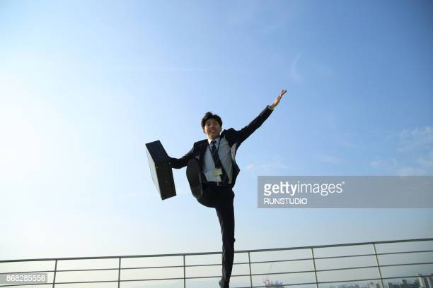 Low angle view of businessman jumping