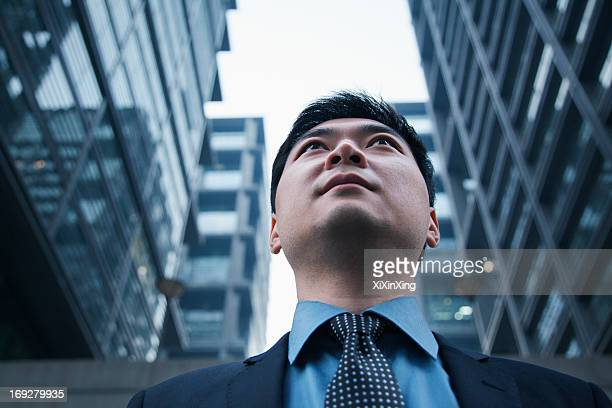 Low angle view of businessman outdoors in Beijing