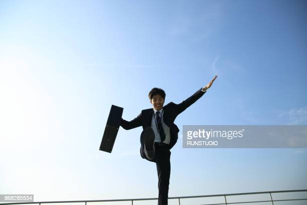 Low angle view of businessman running