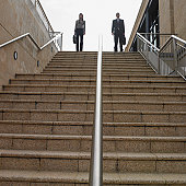 Low angle view of businesspeople at the top of a staircase