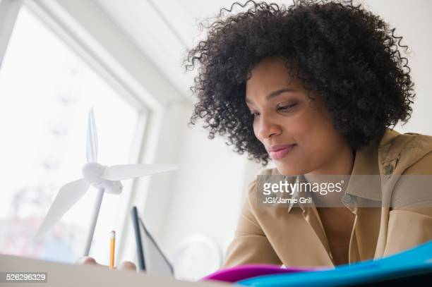 Low angle view of businesswoman working at desk