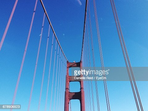 Low Angle View Of Cables Of Bridge Against Clear Sky