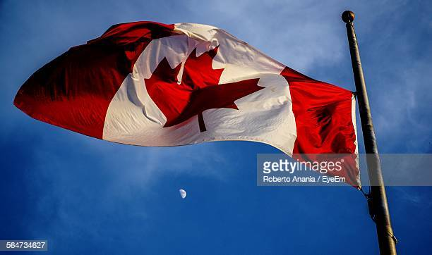 Low Angle View Of Canadian Flag Against Sky