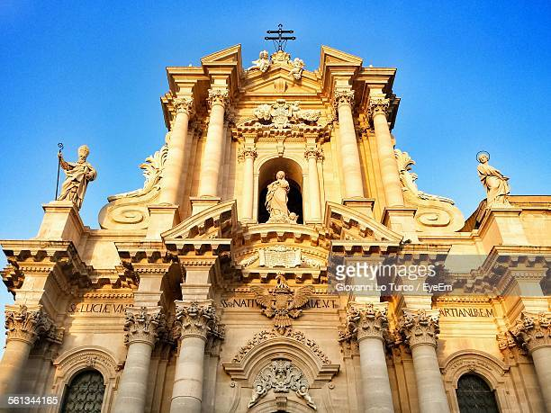 Low Angle View Of Cathedral Against Blue Sky At Sicily