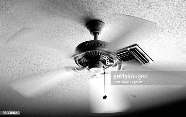 Low Angle View Of Ceiling Fan In Motion