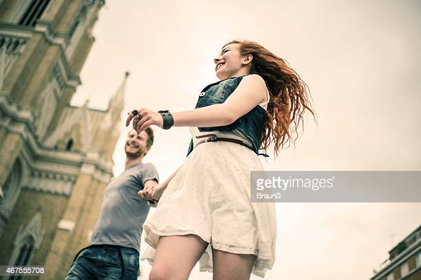 Low angle view of cheerful redhead couple in the city.
