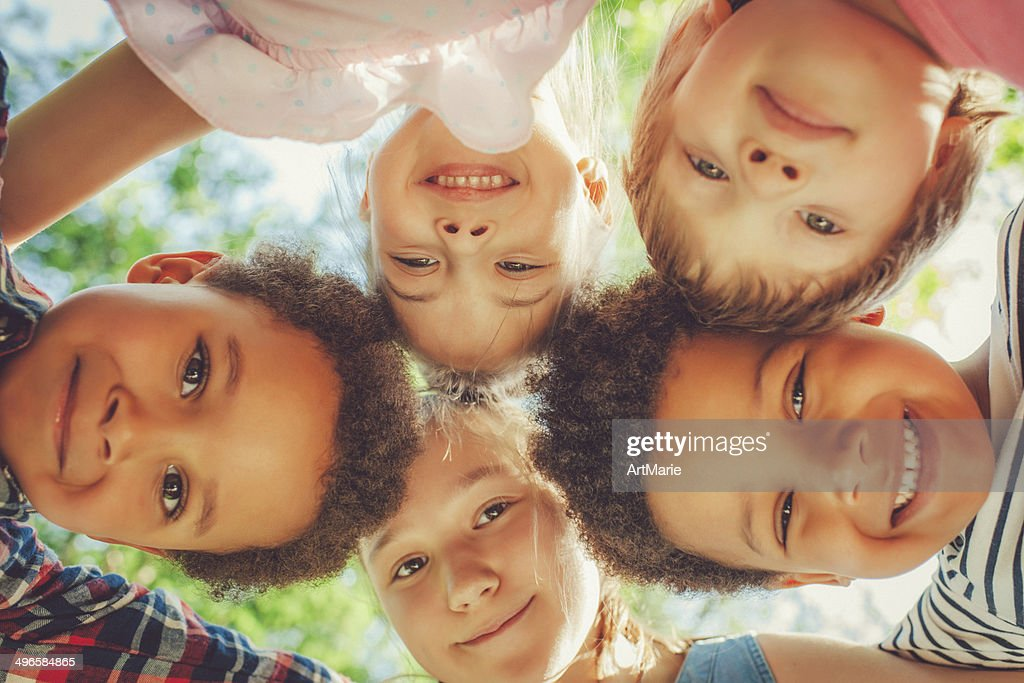 Low angle view of children in a park : Stock Photo