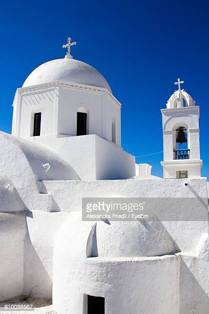 Low Angle View Of Church Against Blue Sky At Santorini